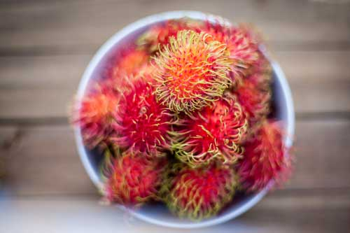 Rambutan fruit in bowl