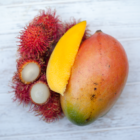 Rambutan and Whole Mango on a Table