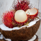 Side View of Rambutans in a Coconut Bowl