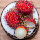Top View of Rambutans in a Coconut Bowl